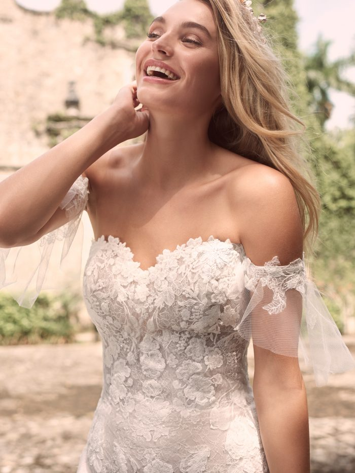 Bride Wearing Sparkly Mermaid Bridal Dress with Lace Arm Bands Called Joelle by Maggie Sottero