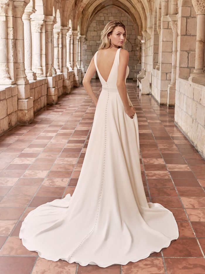 Model Wearing V-back Crepe A-line Wedding Dress Called Josephine by Maggie Sottero