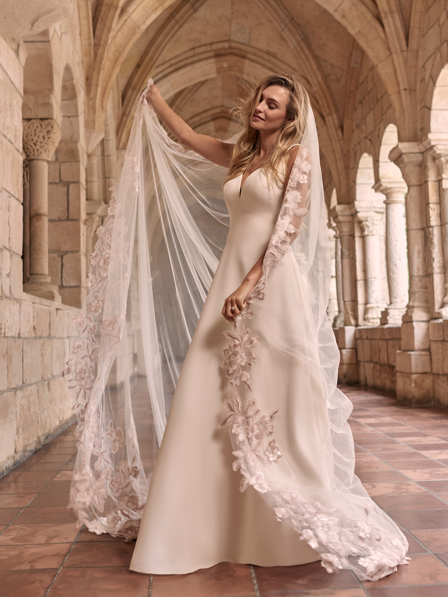 Model Wearing Simple A-line Wedding Dress with Blush Lace Wedding Veil Called Josephine by Maggie Sottero