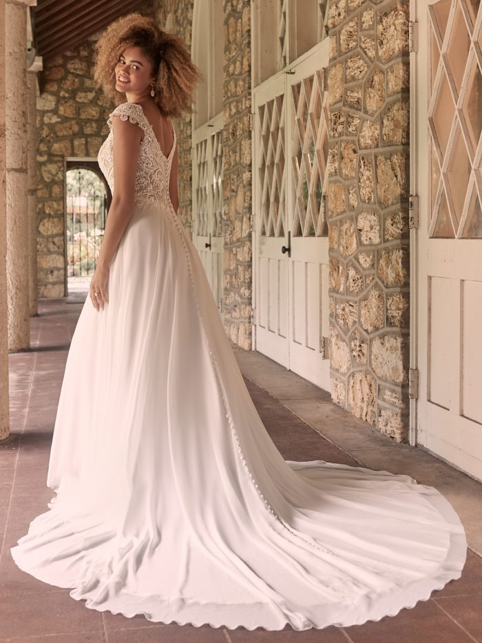 Model Wearing the Best Wedding Dress for Apple Shaped Body Types Called June by Maggie Sottero