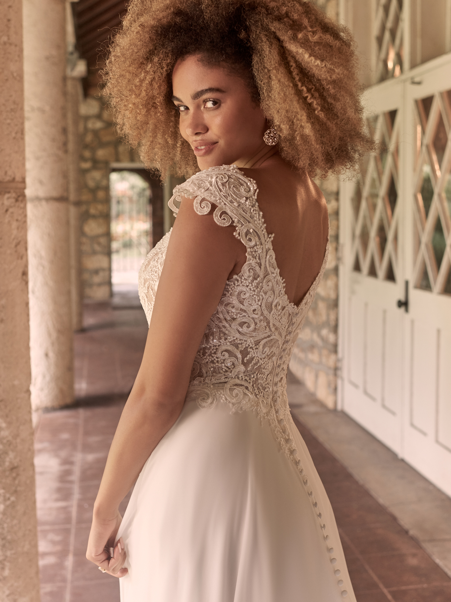 Model Wearing Boho Cap-Sleeve Chiffon Wedding Gown Called June by Maggie Sottero