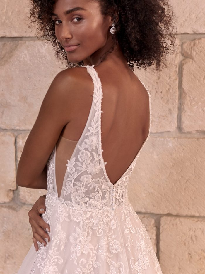 Model Wearing Sheer Bodice A-line Wedding Dress Called Leticia by Maggie Sottero