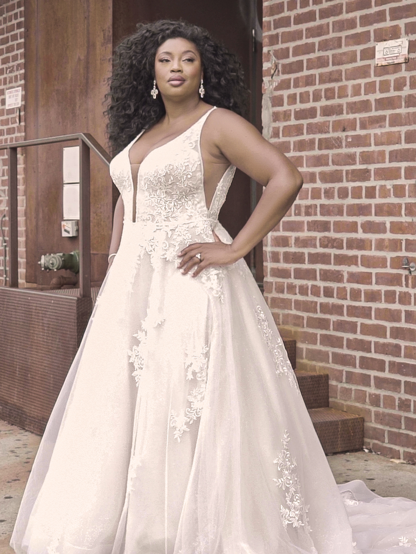 Curvy Model Wearing Plus Size A-line Wedding Dress Called Leticia Lynette by Maggie Sottero
