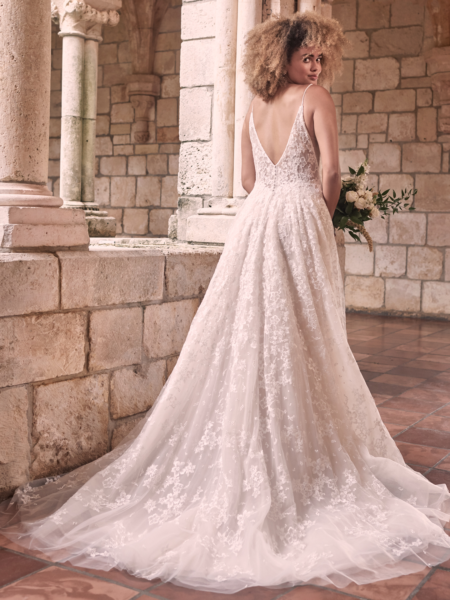 Model Wearing Romantic Floral A-line Wedding Gown Called Lorenza by Maggie Sottero