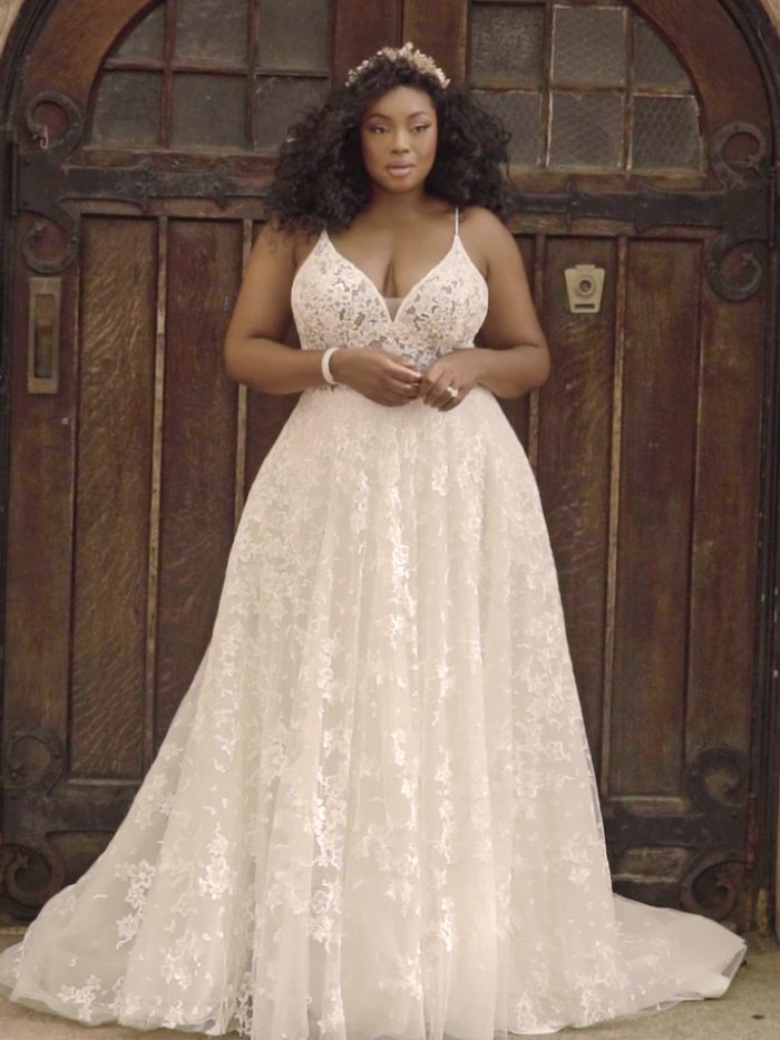 Black Model Wearing Plus Size A-line Wedding Dress Called Lorenza by Maggie Sottero