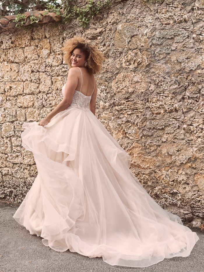 Model Wearing Tulle Tier Ball Gown Wedding Dress Called Timbrey by Maggie Sottero