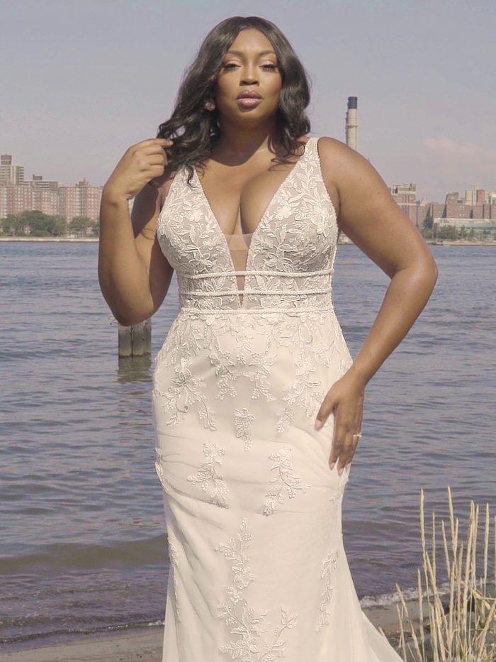 Black Model Wearing Plus Size Floral Sheath Wedding Dress Called Angie by Rebecca Ingram