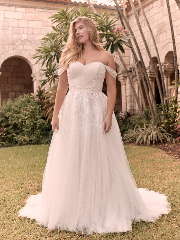 Model Wearing Affordable Off-the-Shoulder Sleeve Wedding Dress Called Floral by Rebecca Ingram