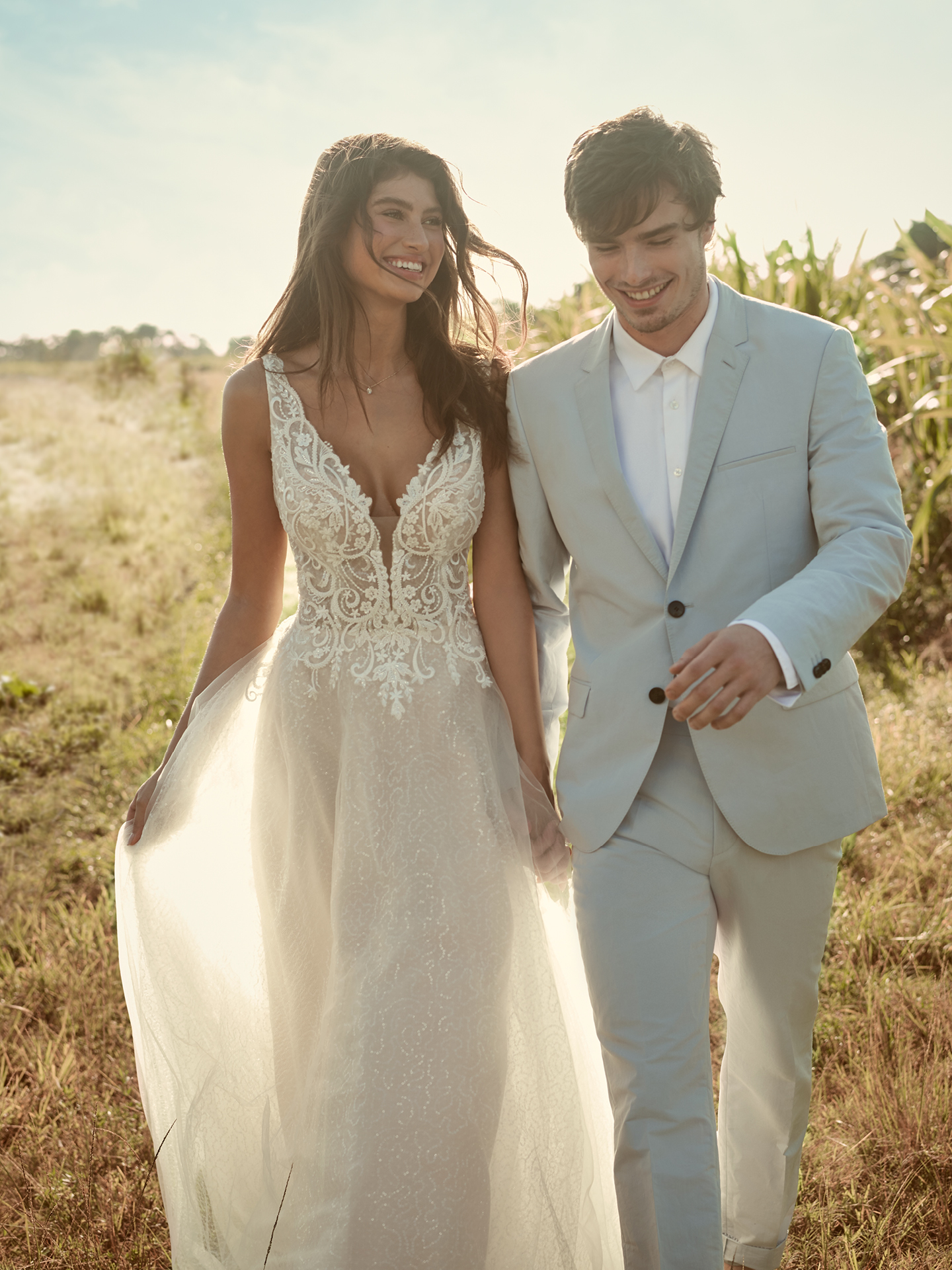 Groom Walking with Bride Wearing Sparkly Tulle Ball Gown Wedding Dress Called Melissa by Rebecca Ingram