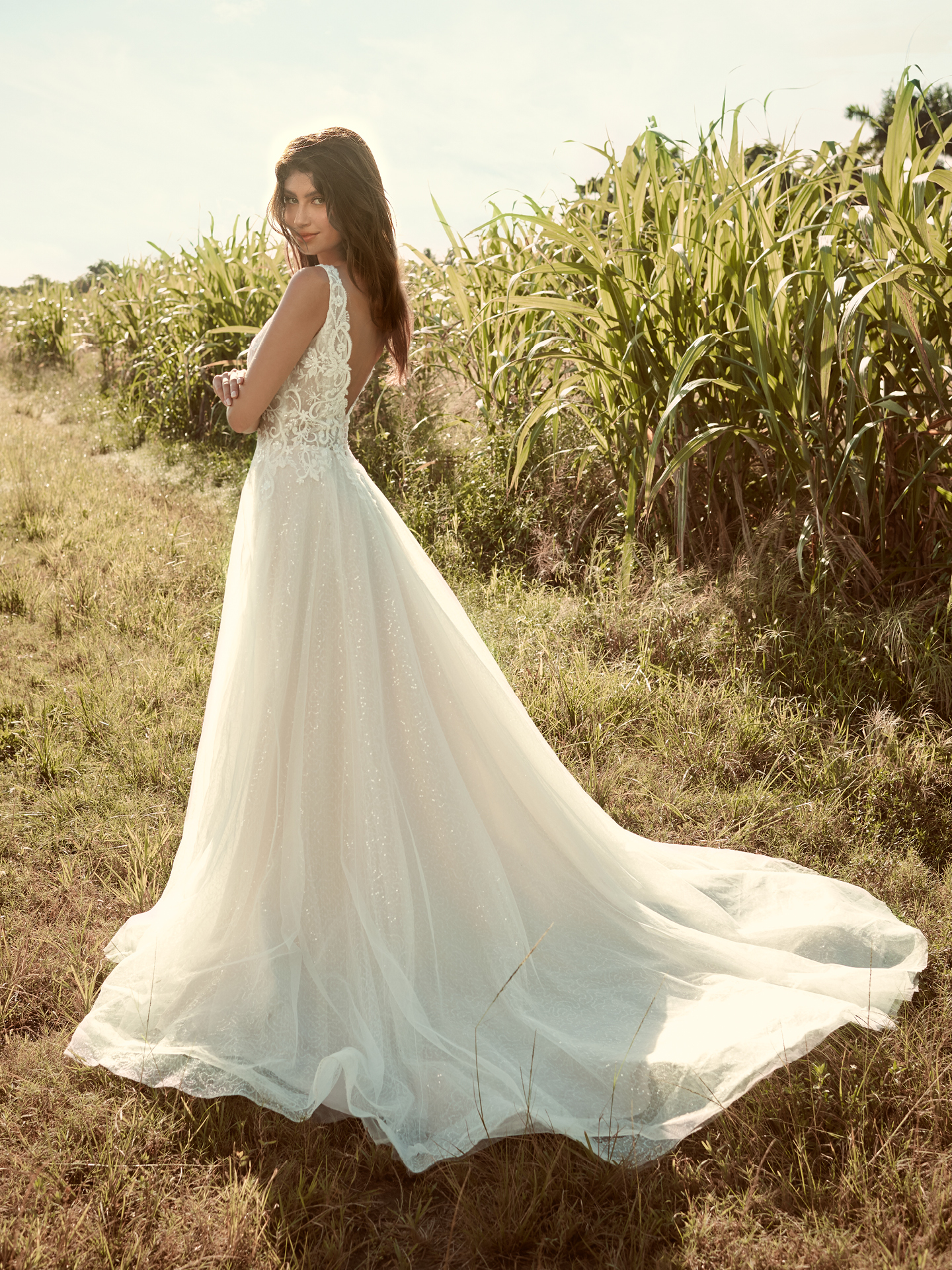 Model Wearing Sparkly Tulle Ball Gown Wedding Dress Called Melissa by Rebecca Ingram