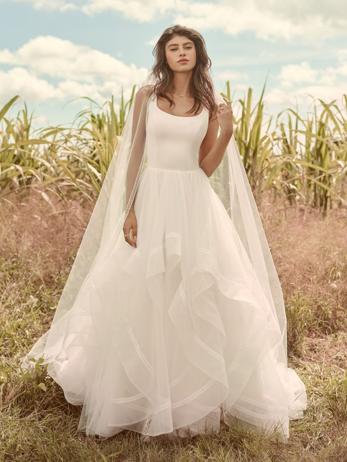 Model Wearing Minimalist Dreamy Ball Gown Wedding Dress Called Rosemary by Rebecca Ingram