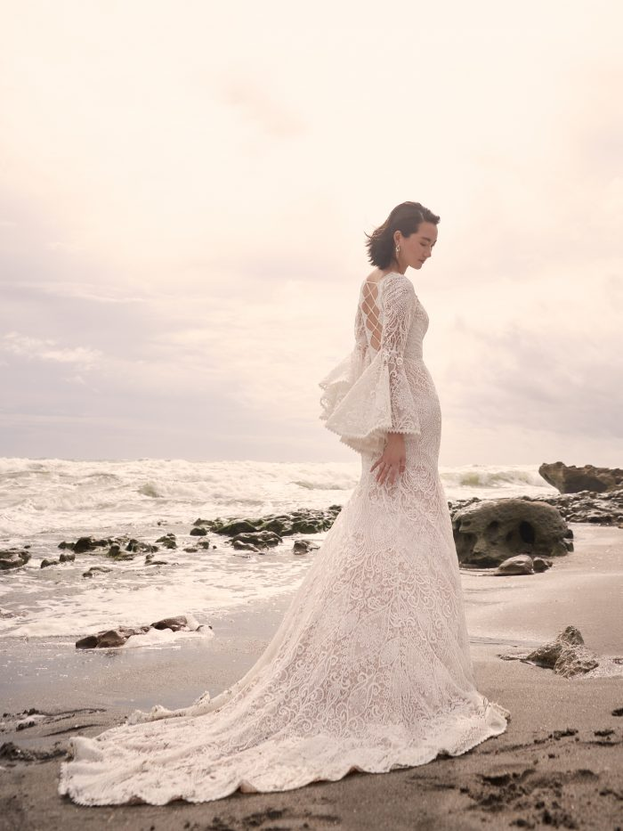 Bride Wearing Vintage Lace Wedding Dress with Bell Sleeves and Rope Corset Called Benson by Sottero and Midgley