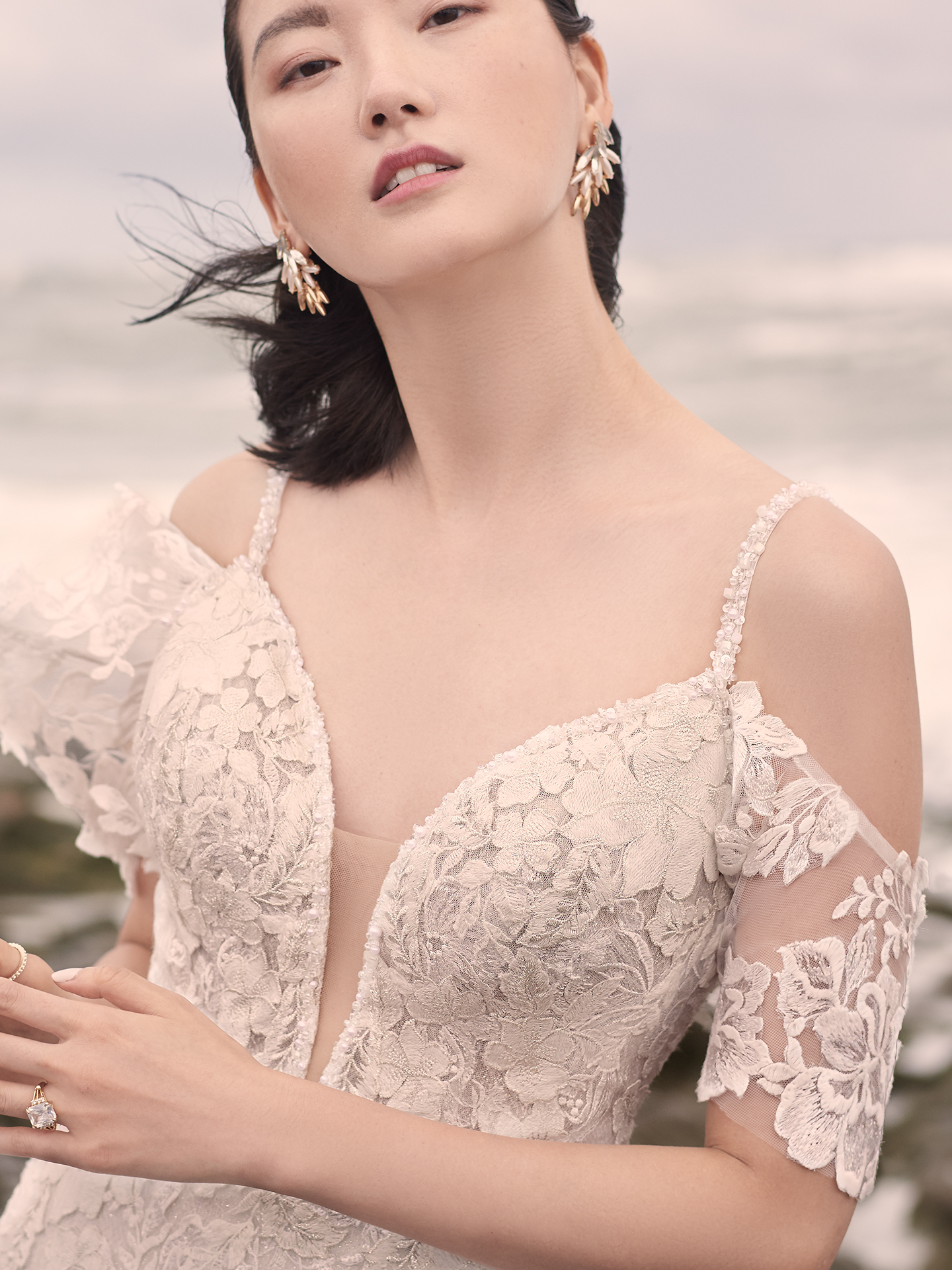 Model Wearing Lace Cold Shoulder Sleeve Wedding Dress Called Bryan by Sottero and Midgley
