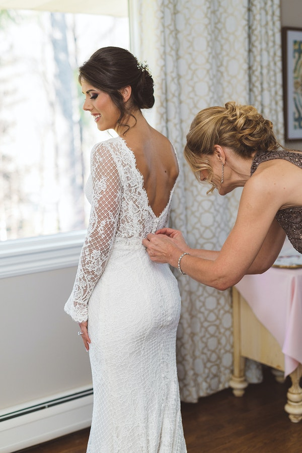 Real Bride Getting Ready and Wearing Lace Sheath Winter Wedding Dress Called Antonia by Maggie Sottero