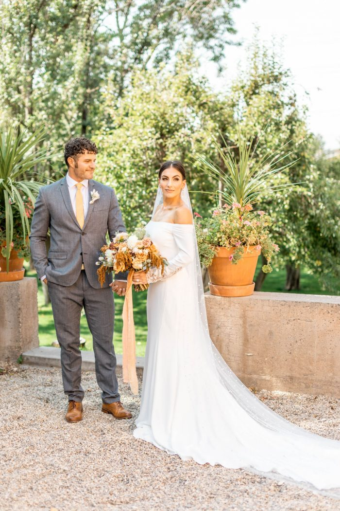 Groom at Italian Wedding with Bride Wearing Off-the-Shoulder Crepe Wedding Dress Called Admina by Sottero and Midgley