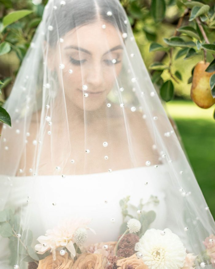 Real Bride Wearing Cathedral Wedding Veil with Pearls Called Pierce by Sottero and Midgley