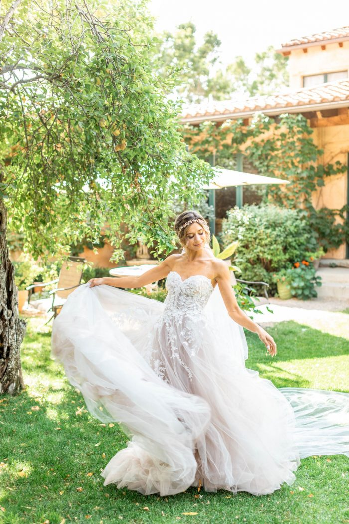 Bride at Italian Wedding Shoot Wearing Strapless Floral Ball Gown Wedding Dress Called Orlanda by Maggie Sottero
