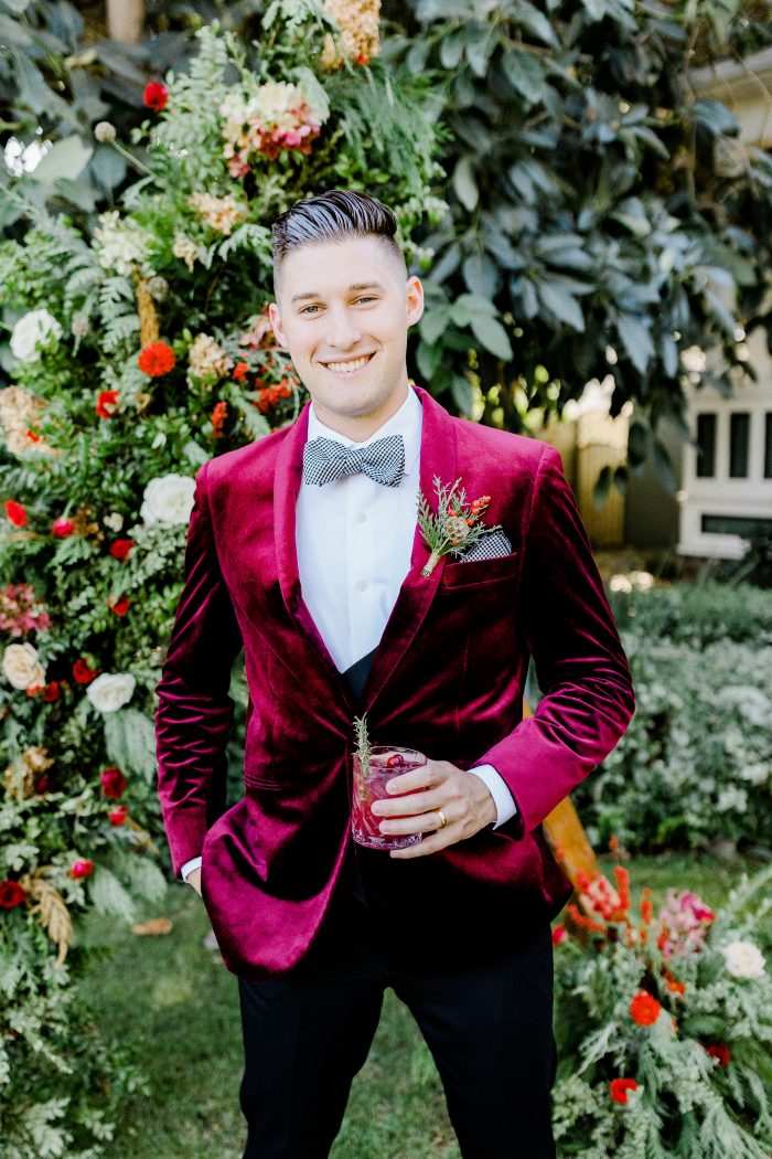 Groom Wearing Velvet Ruby Tux for Winter Wedding