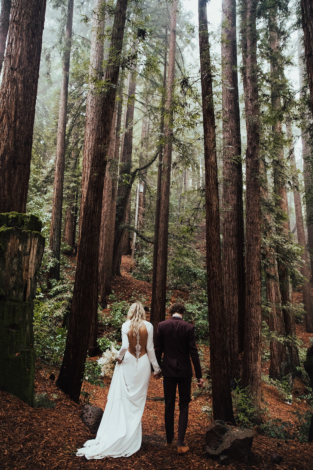 Groom in the Red Woods with Real Bride Wearing Illusion Back Crepe Sheath Wedding Dress Called Arleigh by Sottero and Midgley