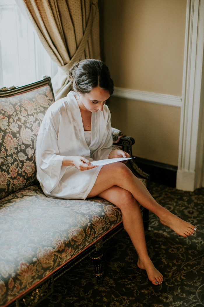 Real Bride in Robe Reading Wedding Vows Before Ceremony