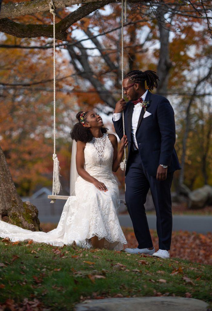 Groom with Bride on Swing Wearing Halter Neck Wedding Dress Called Winifred by Sottero and Midgley