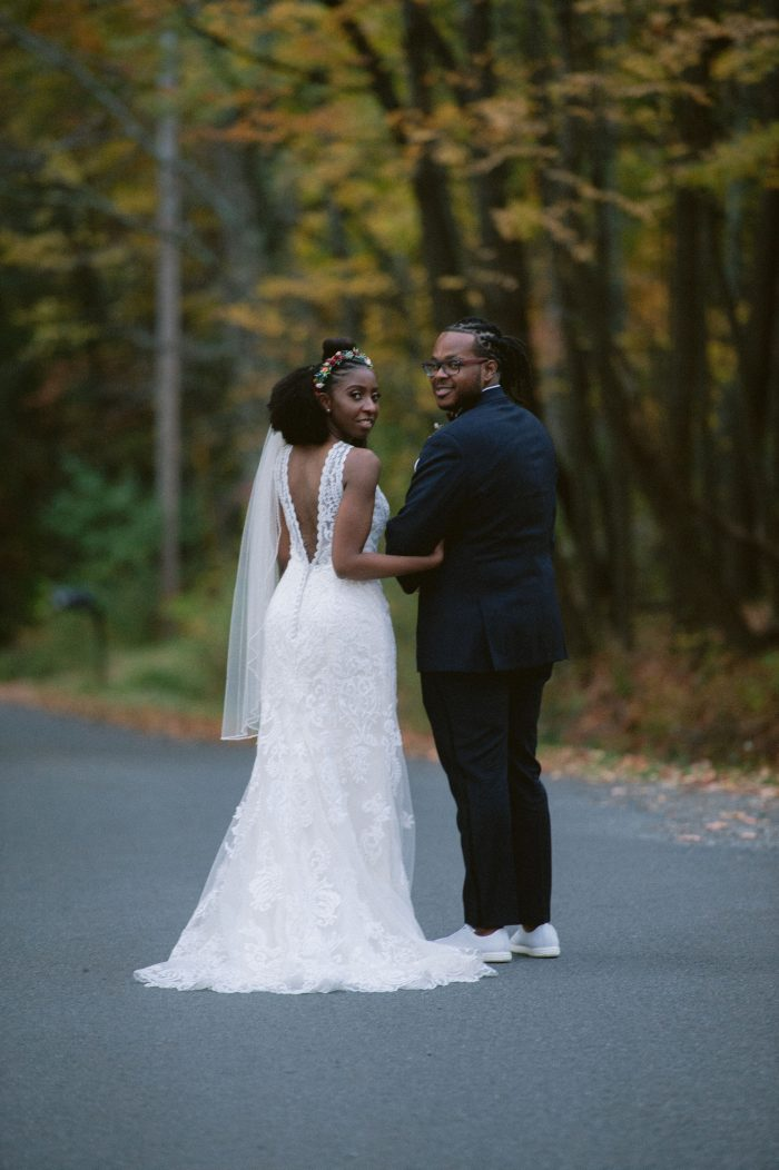 Groom with Real Bride Wearing Lace V-back Wedding Dress Called Winifred by Sottero and Midgley