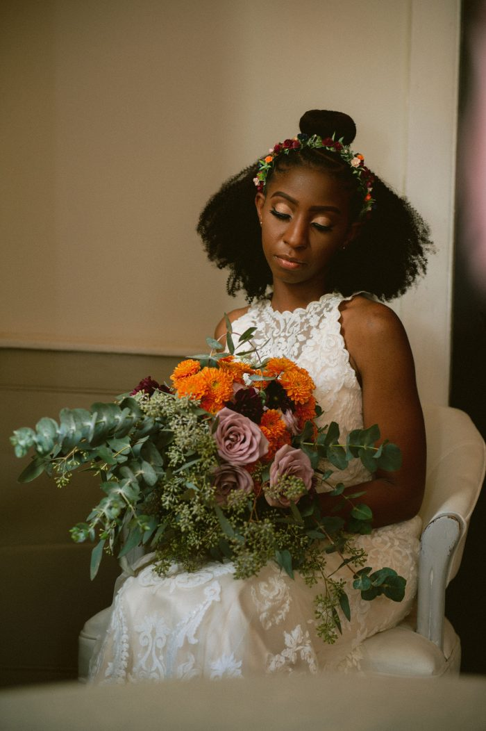 Real Bride Holding Colorful Bridal Bouquet and Wearing Lace Halter Neck Wedding Dress Called Winifred by Sottero and Midgley