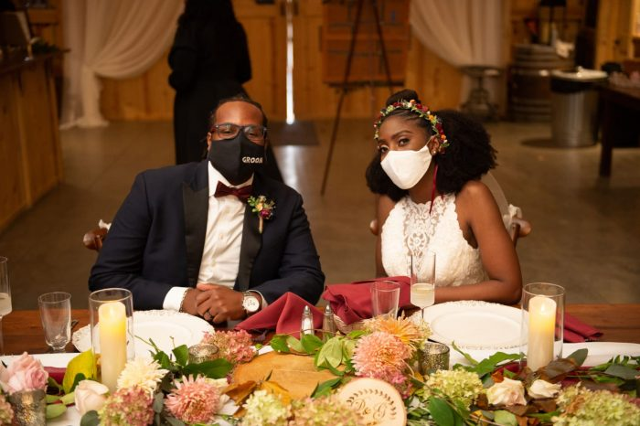 Bride and Groom Wearing Masks After Wedding Disaster Storm