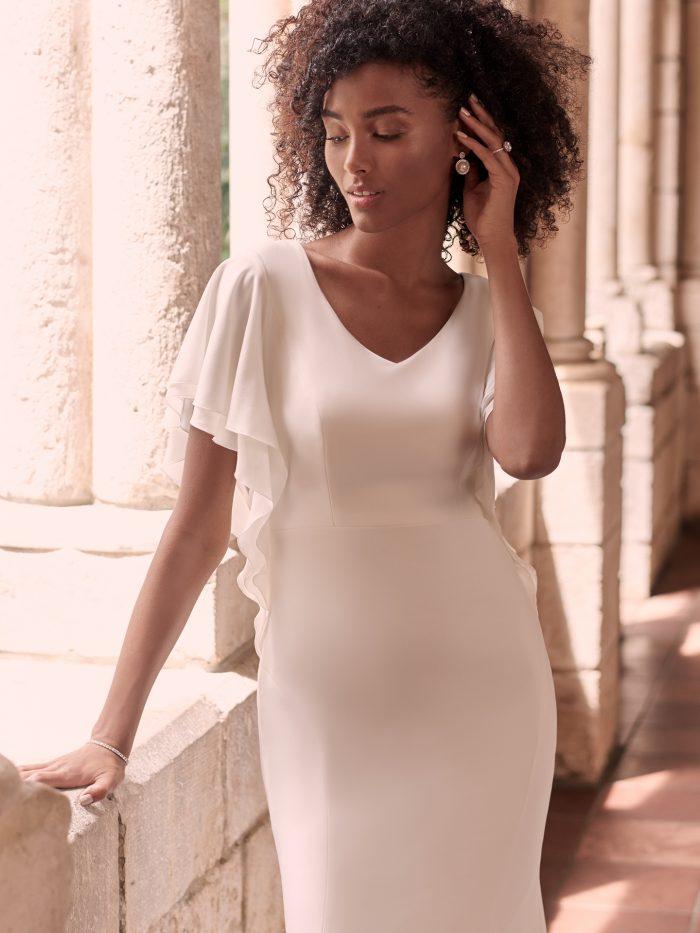 Black Model Wearing Modest Flutter Sleeve Wedding Dress Called Adele by Maggie Sottero