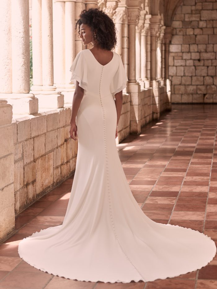 Bride Wearing Modest 1970s Wedding Dress With Flutter Sleeves Called Adele by Maggie Sottero