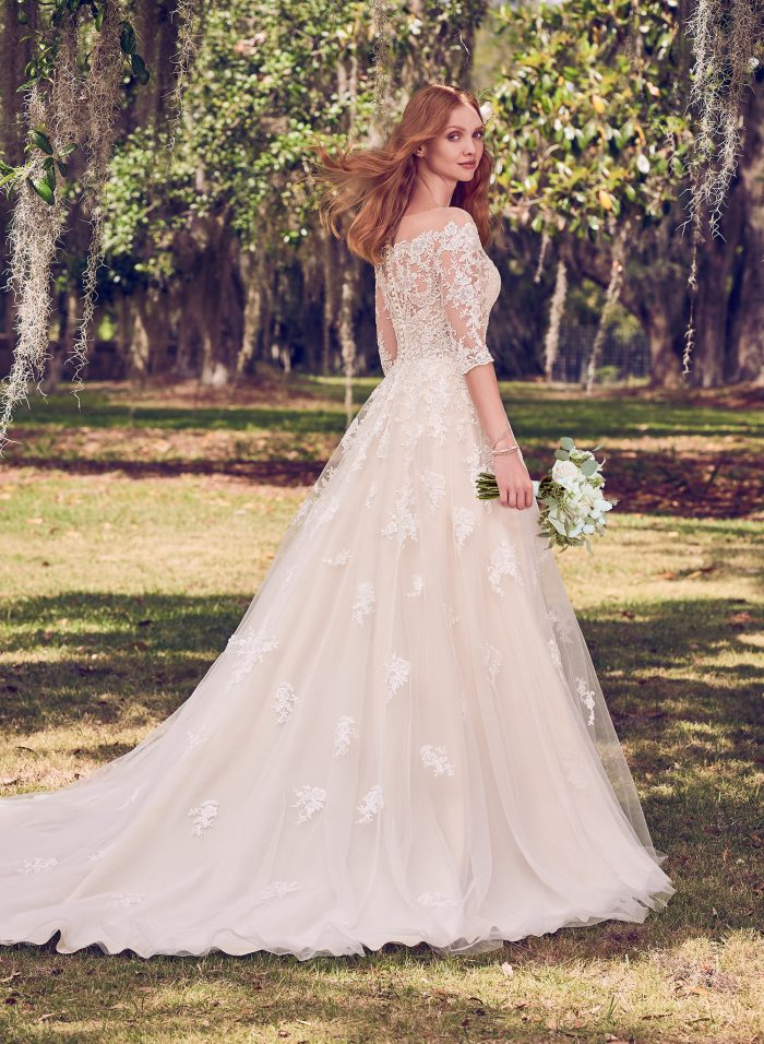 Model Wearing Off-the-Shoulder Lace A-line Wedding Gown Called Bree by Maggie Sottero