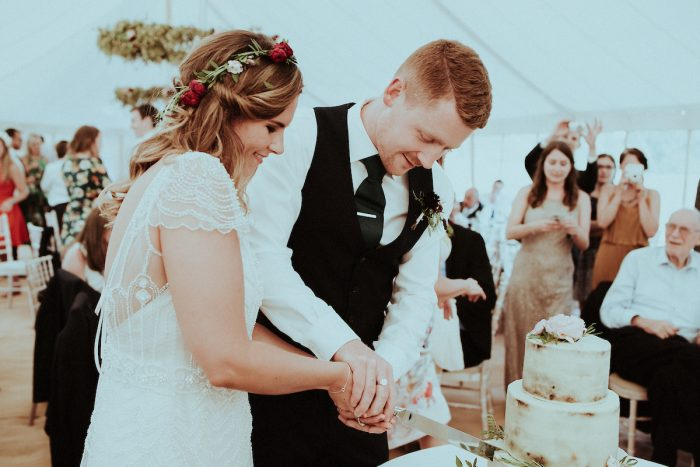 Groom Cutting Cake with Real Bride Wearing Vintage Wedding Dress Called Ettia by Maggie Sottero