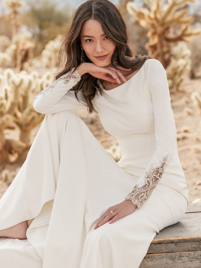 Asian Model Wearing Long Sleeve Crepe Wedding Dress with Embroidered Back Called Aston by Sottero and Midgley