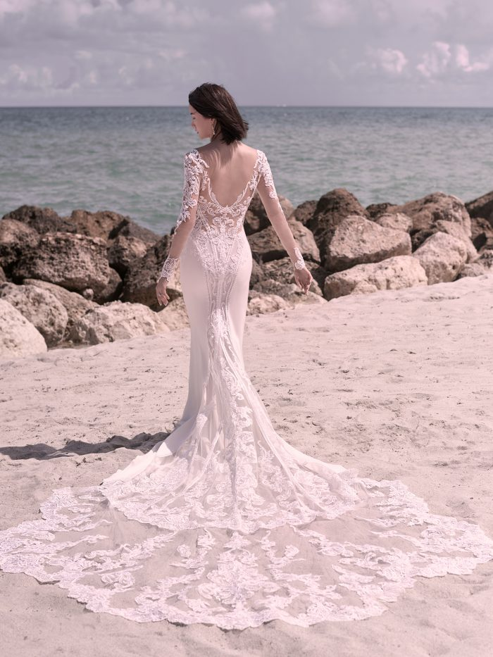 Bride on Beach Wearing Illusion Lace Sheath Wedding Gown Called Cambridge Dawn by Sottero and Midgley