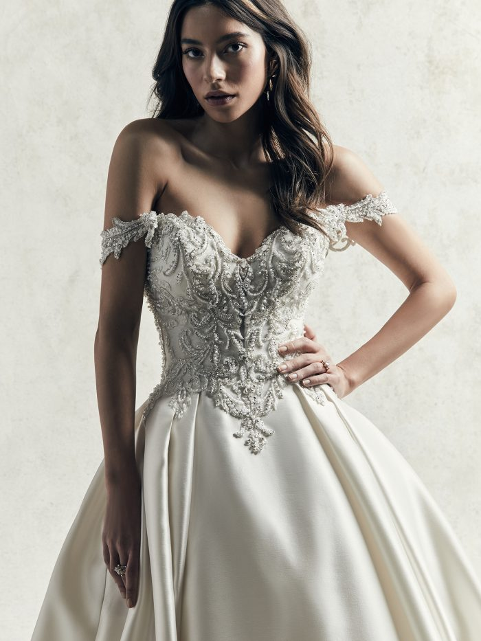 Model Wearing Luxe Satin Ball Gown Wedding Dress with Off-the-Shoulder Sleeves Called Kimora by Sottero and Midgley