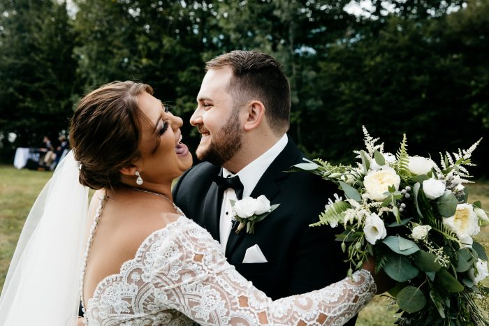 Groom Dancing with Real Bride Wearing Lace Ball Gown Wedding Dress Called Mallory Dawn by Maggie Sottero