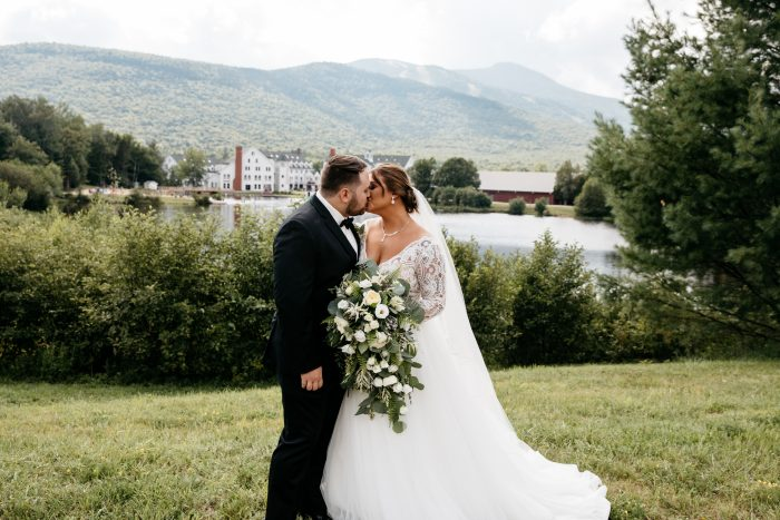 Groom Kissing Bride Wearing Scallop Lace Princess Wedding Gown Called Mallory Dawn by Maggie Sottero