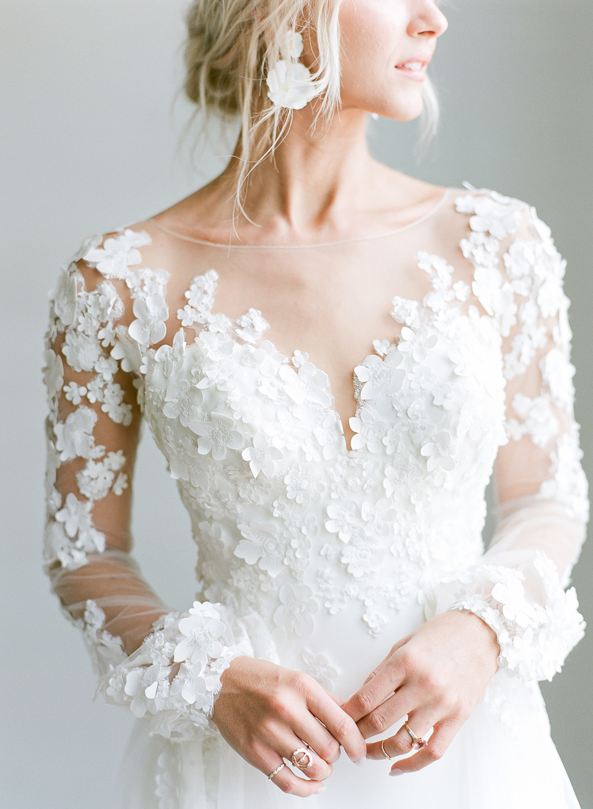 Model Ashlee Jensen Wearing Custom Maggie Sottero Wedding Dress with Illusion Lace Floral Bishop Sleeves