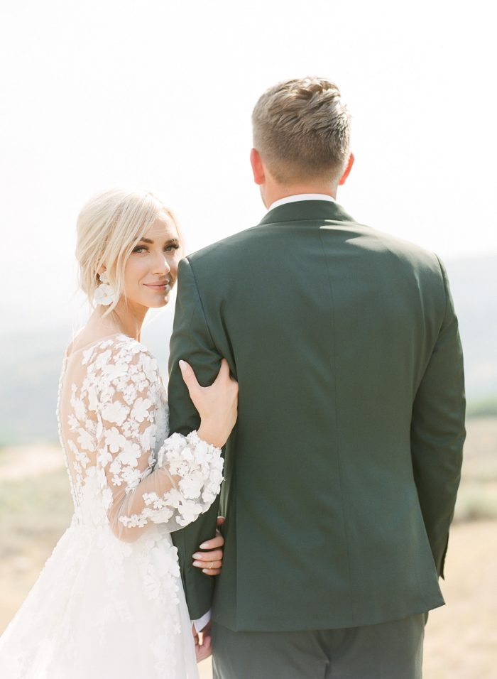 Groom with Bride Wearing Custom Maggie Sottero Wedding Dress with Illusion Bishop Sleeves