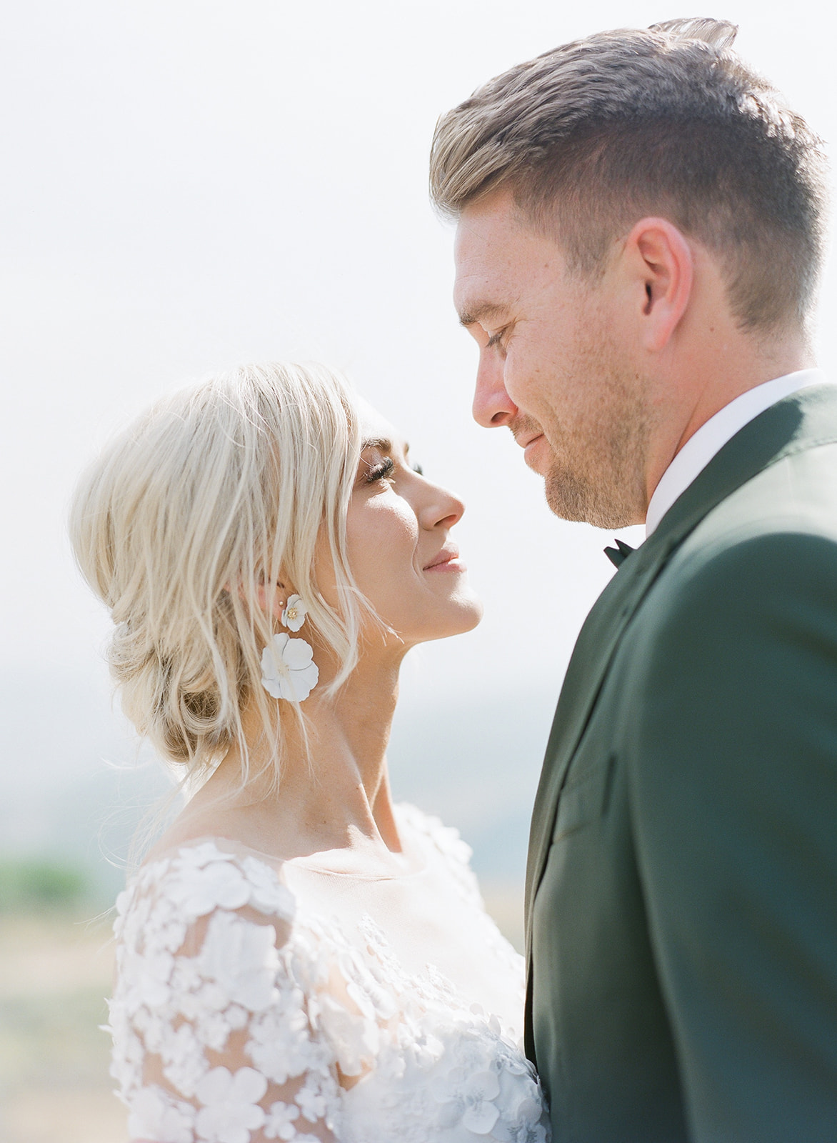 Ashlee Jensen at Summer Wedding Looking at Dane, Her Groom