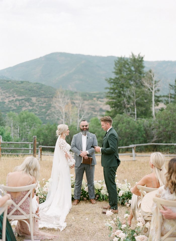Groom Saying Vows to Bride During Summer Wedding Ceremony