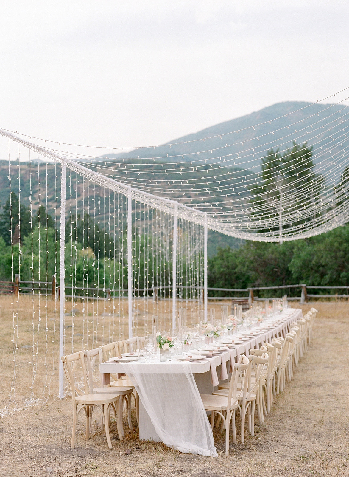 Rustic Table Settings with Hanging Lights at Summer Wedding in the Utah Mountains