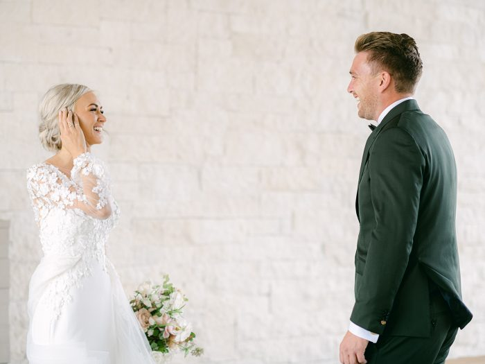 Bride Ashlee Jensen Wearing Maggie Sottero Wedding Dress and Having First Look with Fiance Before Their Wedding