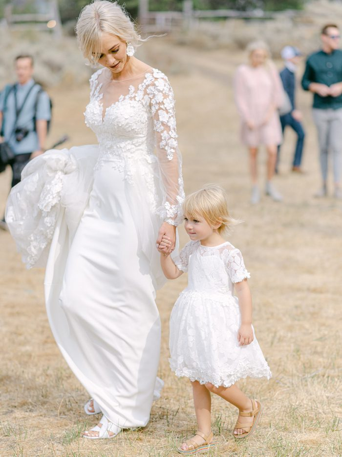 Bride Wearing 3-D Floral Sheath Bridal Gown Called Arta by Maggie Sottero and Walking with Her Daughter