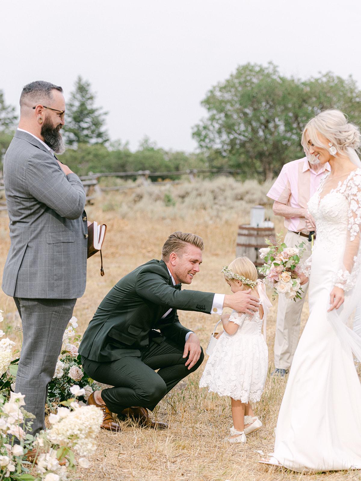 Groom Hugging Bride's Daughter During Intimate Wedding Ceremony