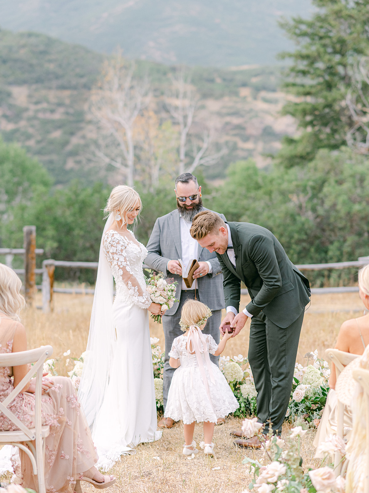 Little Daughter with Parents During Their Wedding Ceremony