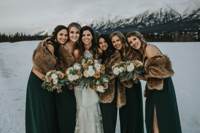Bride Wearing Maggie Sottero Wedding Dress with Bridesmaids Wearing Pine Green Wedding Dresses