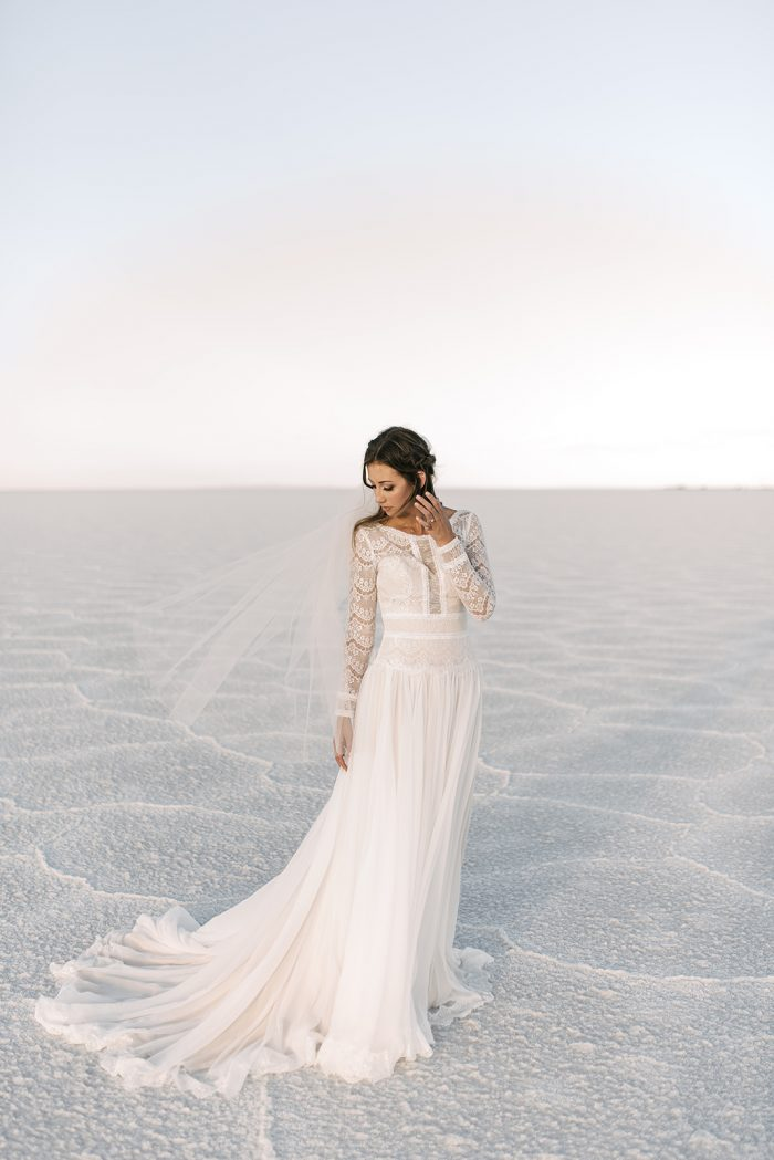 Real Bride at Salt Flats Wearing Lace Long Sleeve Winter Wedding Dress Deirdre by Maggie Sottero