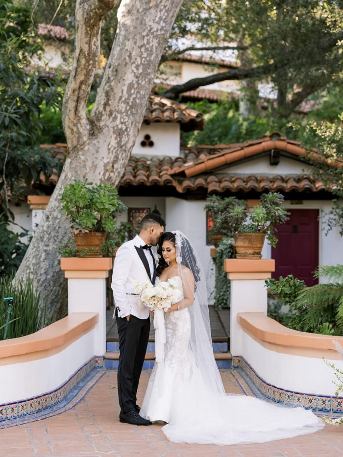 Groom with Real Bride Wearing Glamorous Satin Mermaid Wedding Dress Called Milena by Maggie Sottero