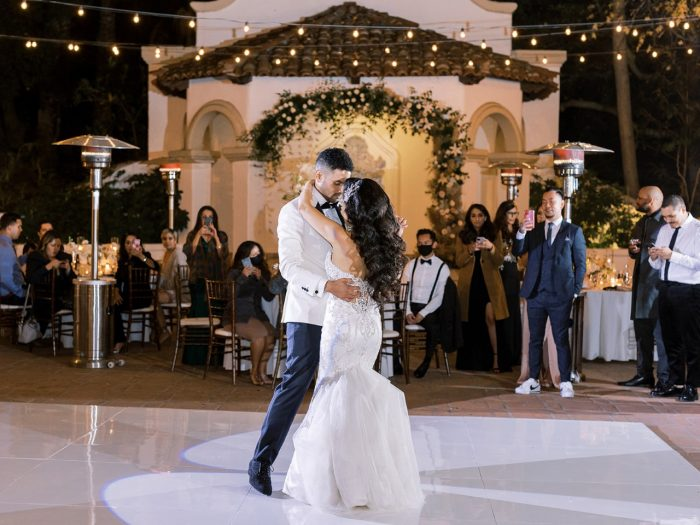 Groom Dancing with Bride Wearing Embroidered Satin Mermaid Wedding Dress Called Milena by Maggie Sottero
